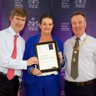 Kerryman journalist Marisa Reidy receiving her merit award at the Justice Media Awards with Director General Ken Murphy and Law Society President Simon Murphy