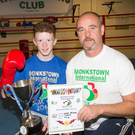 Mike McCarthy (left) of Tralee Boxing Club who was victor in the 40kg category at the Monkstown Box Cup in Dublin on Sunday with his fitness coach Andy Doyle