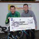 At Enable Ireland Tralee's HQ last Thursday Tommy Sheehy presented Sean Scally of Enable Ireland with a cheque for €10,870