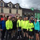 Valentia Ring of Kerry cyclists in Sneem with some Iveragh friends. Front:(from left) Con O'Shea, Pat O'Connor, Liam Lynch, Brendie Murphy, Junior Murphy, John Shanahan, Martina Reardon, Phil O'Dowd and Cian McCrohan. Back: Pa O'Connell, Eoin O'Connor, Brendan O'Connor