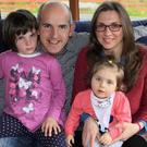 Brendan and Nancy Falvey with daughter Hannah, who suffers from Rett Syndrome, and her big sister Lily