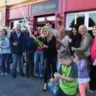 It's champers time at O'Brien's in Duagh as Breda Brosnan pops the cork in front of double winners Batsy and Sandra Maher (her sister) on Monday evening