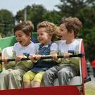 Thomas, Sevan and Daniel O'Connor from Abbeydorney enjoying the fun fair on Sunday