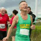 Tiger O'Flaherty shows signs of elation as he finishes his 100th marathon