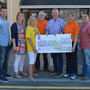 Colin Aherne, Stephanie Turner, Marilyn O' Shea, Martin Brosnan, Kieran O' Brien, Ann O' Shea and Aidan O' Sullivan pictured in Tralee with a cheque for €45,226 for Pieta House, proceeds from the Darkness Into Light Tralee event. Photo by Fergus Dennehy