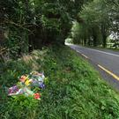 Flowers near the spot at Bealkilla, Lixnaw, where Listowel man James Joy lost his life in a crash last week. Photo by Domnick Walsh
