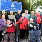 Debra, Danny and Dolly Lawlor Tralee, Philip and Jerry O'Brien Sneem, Thomas and Jeremiah Bambury Kenmare (back from left) Maria and Donal O'Sullivan Callinafercy, Pat Perryman Listowel and Jack Fitzpatrick Cahersiveen at the gates of St Mary of the Angels run by St John of God Kerry Services in Beaufort on Tuesday morning. Photo by Michelle Cooper Galvin