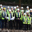 Jo Jo O'Dwyer, Principal, (front second from left), with Kieran Cusack MD Conack Construction, Cormac Kane Architect, Nigel Crowe, Kane Crowe Kavanagh Quantity Surveyors, ISK students Tom Whittleton, Senan O'Meara, James Treacy, Grainne O'Connor, Holly Clifford; (second row) Darragh O'Regan ISK, Kerry footballer and past pupil Johnny Buckley; (back row from left) Eoghan Mcgillicuddy MRG Consulting Engineering, James O'Mahony ISK Vice Principal, Kim Jacobsen, Michael Hession, Frank Geary, Kieran O'Brien and Con Flaherty of Conack Construction at the site of the new Science Lab at the Intermediate School, Killorglin on Tuesday. Photo by Michelle Cooper Galvin