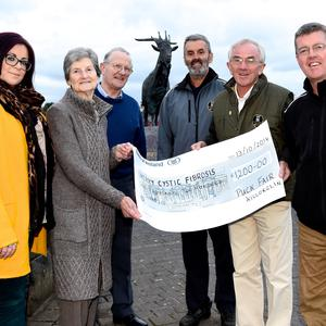 Puck Fair Chairman Declan Mangan (fifth from left) presenting the proceeds of the Puck Fair special collection of €1,200 to Mary and Liam Burke for the Kerry Cystic Fibrosis with (from left) Laura Healy, Declan Falvey and Pat Cahill of the Puck Fair Committee in Killorglin. Photo by Michelle Cooper Galvin