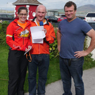 Miriam Lyne (left), who was the second lady home in the Valentia Island Half Marathon with Vincent Kidd of the Royal Hotel and Con O' Shea, organisers of the marathon