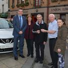Maurice Regan from Farranfore, pictured with his wife Eileen, and Lisa Clifton, is presented with the keys to his new Nissan Pulsar by David Randles (Randles Brothers Garage) and TCU CEO Fintan Ryan