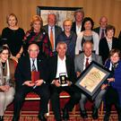 Photographed at the presentation to Fr Shay Cullen of the Hugh O Flaherty Humanitarian Award in The Killarney Avenue on Saturday night, were front row from left, Deirdre O Reagan, Senator Paul Coughlan, recipient Fr Shay Cullen, Mayor Brendan Cronin and Pearl Dineen. Back row, Jerry O Grady, Deirdre Walton, Grainne Kenny, Matt Moran, Claire Carey, Greg Canty, Christine Harrington, John O Reagan, Maureen O'Sullivan and Fr. Pat Rahilly. Photograph by Sally MacMonagle