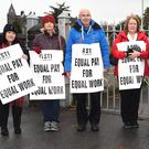 ASTI members Mary Cotter, Delores McSweeney, John O'Keeffe, Aisling Coffey, Maureen Dillon, Joan Morrissey, Marie Cahill and Elaine Daly on the picket line at St Brigid's, Killarney on Tuesday. Photo Michelle Cooper Galvin
