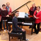 Getting to know the wonderful new Yamaha piano: Kenmare Choral Festival committee members Maura Sheehan, Harry O'Connor, Ornait Ni Loingsigh, Kieran Finnegan, Kathlyn O'Brien, Sue O'Connor and Veronica Whitehead