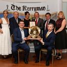 Jim Garvey, representing Garvey's SuperValu, accepts the trophy as overall winner of the inaugural Kerryman Business Awards from Kerryman MD John Feerick at the awards ceremony in Ballgarry House Hotel, Tralee, on Friday night. With them were, back from left: MC Maria Walsh, Guest Speaker Gavin Duffy, Garvey's Supervalu Tralee Manager Sandra Leahy, Garvey's MD Kevin McCarthy, Kerryman Editor Kevin Hughes, and Kerryman Advertising and Marketing Manager Siobhán Murphy