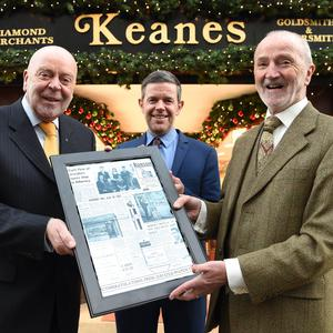 Pat and Gerard Keane and (centre) Paul Trant, Manager Keanes, celebrating 50 years in Killarney with a copy of the Kerryman from 1966