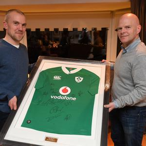 Brian Scanlon and Patrick Treacy with the famous signed Irish jersey nabbed by the latter following the All-Black defeat in Chicago and now up for auction in aid of Árus Mhuire's Brain Injury unit. Photo by Domnick Walsh