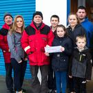 At the presentation of a cheque for €385 to Ballybunion Sea & Cliff Rescue were, from left: Frank O'Connor (PRO), Mike Flahive (Treasurer), Caoimhe Barry, TJ McCarron (Chairman), Eoin Sheahan, Aoife Sheahan, Shauna Barry, Odhran Barry, Josh Enright (BBSR), and Liam Mulvihill (Safety Officer).