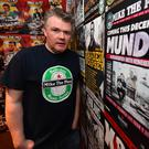 Mike the Pies proprietor Aiden O'Connor by the wall of fame in the Listowel bar that's carving out a national name for itself