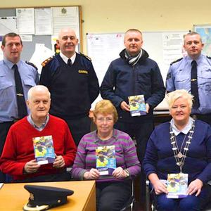 Members of the Killorglin CCTV Committee at their recent meetings with senior gardaí over concerns about the ongoing funding of the town's crime-busting camera network. Front, from left, Gary Ledwith, Maureen Gamble and Helen O'Shea. Back from left: Sgt Mike Quirke, Chief Superintendent Tom Myers, Cllr Damian Quigg, Sgt Mike Fleming, CCTV Committee Chairperson Billy Browne and Gda Eamon Prenderville. The group hold special books in which people can log their valuable possessions