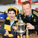 Dr Crokes Captain Johnny Buckley with Cormac Murphy at St Oliver's National School, Ballycasheen, Killarney on Tuesday. Photo by Michelle Cooper Galvin