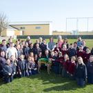 Pupils and staff of Scoil Naomh Eirc in Kilmoyley, with Kingdom Greyhound Stadium manager Declan Dowling and a four-legged friend at the launch of the school's fundraising night at the dogs. It takes place on June 3