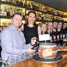 Managers Paudie Sweeney and Maura Crowley along with their staff welcome Kerry footballer Marc O Sé to the 'Celtic Whiskey Bar and Larder' in Killarney to celebrate the bar's first year in business. Photo by Sally MacMonagle