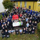 Scoil Saidhbhín in Cahersiveen was filled with lots of excitement when Lee Strand visited this week to present a cheque of €500 in the Cash 4 Schools Draw. Photo by Domnick Walsh