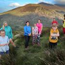 Killarney Walking Festival is delighted to announce This year's Charity Walk - a sun 'set' on Strickeen, on Friday, June 9, will be in aid of'Bus Fund' Kerry Parents and Friends. Walkers should meet at Kate Kearney's Cottage on Friday at 7.30pm, collection on the night. From left: Avril Rooney, Marie Kehoe O'Sullivan, Agnes Rooney, Kayla and Ciara Roche, Denis O'Sullivan, John O'Sullivan of Killarney Walking Festival and James Rooney. Photo by Valerie O'Sullivan