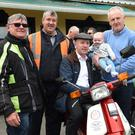 Tim Fleming, Eamon Burke, Deputy Michael Healy Rae, Tom O'Regan and his granddad Noel Brosnan at the start of the 10th Annual Ring of Kerry Honda 50 Charity Run at the Old Killarney Inn, Aghadoe, Killarney on Sunday. Photo by Michelle Cooper Galvin