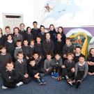 Curraheen National School pupils front from left: Sam Kelly, Cathal Griffin, Jacob Callaghan, Kevin Walsh, Nathan Leahy Breen, Ryan McCarthy, Dylan Riordan, Calum O'Connor (centre row from left) Eoin McCarthy, Katelyn O'Connor, Liam O'Connor, Cathal Clifford, Dawn Griffin, Lucas Riordan, Leona Clifford, Darragh Lynch, Aaron Griffin, Anthony Diggin, Marissa O'Shea (back from left) Donna Diggin, Emily Murphy, Craig Clifford, Sinéad Clifford, Sinéad King, Melissa Callaghan, Caleb Callaghan, Róisin King, Andrea O'Shea, Alisha O'Shea at the unveiling of the Art Project at Curraheen National School, Glenbeigh. Photo by Michelle Cooper Galvin