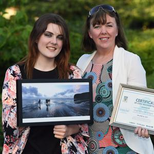 Overall winner of the GoKerry Kerryman photography contest was Grace Ellen McElligott from Ballybunion pictured with her winning picture captured on Ballybunion beach. Ellen is pictured with her mum Siobhan