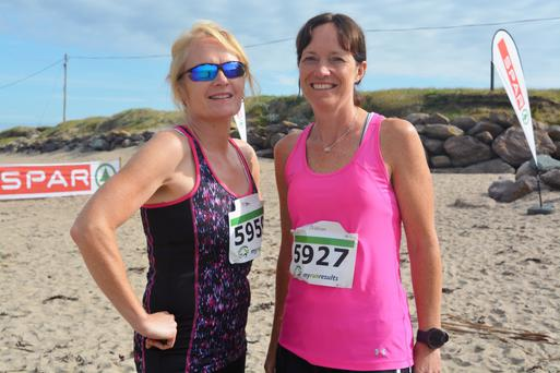 Niamh Cullinane and Cathy Barry pictured enjoying the sun at the Brandon Bay Half Marathon and 10k Run on Sunday morning