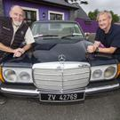 Tom (left) and George Glover of the Kingdom Veteran Vintage & Classic Car Club and Honda 50 Charity Run at Ó Riada's Bar and Restaurant in Ballymacelligott to announce the route and time of Friday evening's run. Photo by John Reidy