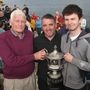 Mr Costelloe and Donald Walsh present the overall winner of this year's memorial swim, Nial Ó Liongsigh, with the Donald Walsh Memorial Trophy. All Photos Domnick Walsh