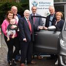 Pat Delaney, Chairman, Killarney Credit Union (fourth from left), presenting the keys of the new Suzuki to winner of the Killarney Credit Union Members Draw, Helen Brosnan, with (from left): Liz and Tom O'Regan, Dermot Healy of Healy Motors, main Suzuki Dealers, Mark Murphy, CEO, Killarney Credit Union, and Noel Brosnan at Killarney Credit Union on Monday. Photo by Michelle Cooper Galvin