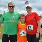 Randall Wharton pictured with his son Lee and his wife Catherine at the St Brendans Park FC fun run on Sunday morning