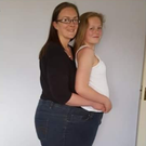 Stephanie and daughter Emma trying out her old pair of jeans in a great demonstration of the weight loss she's experienced