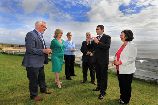 From left: Pat Spillane, Josephine O'Driscoll, Caithlín Breathnach, Michael Ó hÉanaigh, Minister of State Brendan Griffin, and Kerry County Council Chief Executive at the Uíbh Ráthach Gaeltacht Interagency Taskforce launch in Ballinskelligs. Photos by Valerie O'Sullivan