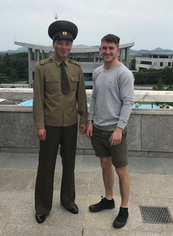 Rory Cheevers with a North Korean guard at the DMZ on the border with South Korea