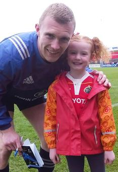 Munster Rugby fan Hanna with hero, Keith Earls