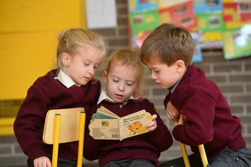 Triplets Lucy, Laura and Donal McMahon on their first day at Duagh NS on Thursday