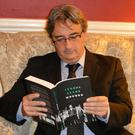 Fergal Keane pictured with his new book 'Wounds'