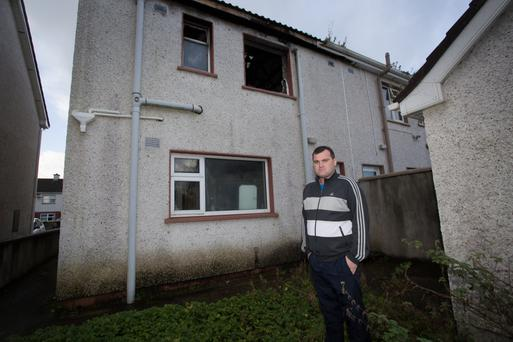 Anthony Kiely at the rear of the burnt out house in Moyvane that is still open to the elements.