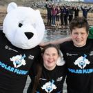 Mascot 'Bear Chills' braves the water at Fenit Beach with Special Olympics athletes Mary Claire McCarthy, Jonathan Kerins and Brendan O'Connell for the launch of Kerry's first Polar Plunge on December 9
