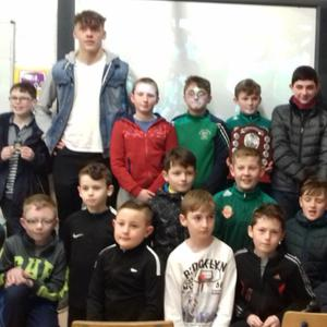 Kerry star David Clifford meets the St Joseph's NS pupils in Castlemaine