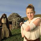 Scoil an Fheirtéaraigh pupil Nell Ní Shé makes a very convincing 'Rey', with Emerald Garrison member Alan Bell in the role of Luke Skywalker, at the beehive huts in Gleann Fán during Féile Star Wars