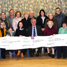 Denis Tangney (seated fifth from left) presenting the year's Mid Kerry Vintage Charity cheques to Siobhan McSweeney Recovery Haven, Therese Walsh Oncology Unit UHT, Sr Helena St Joseph's Killorglin and Marie O'Sullivan Castlemaine Community Centre with Brendan Dennehy, Anne McSweeney, Michael McKenna, (back from left) Cllr John Francis Flynn, Helen Cronin, Michael Flynn, Denis Coleman, Marian Barnes, Marian Crowe, John Griffin, Eileen Courtney, Sr Elizabeth, Coleman O'Sullivan, Eileen Flynn, David Loveland Mary Sheehan at Castlemaine Community Centre on Thursday. Photo by Michelle Cooper Galvin