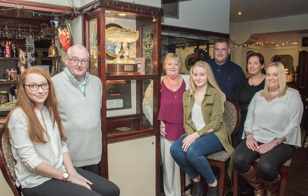 Rachel Conrad, Peter Conrad, Patsy Conrad, Molly Conrad, Michael Conrad, Alanna Kelleher and Kate Keane pictured with the Kay and Paddy 'Fear' Memorial Trophy at The Fertha Bar