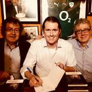 Brian Devaney at the launch of his new study of John B Keane'swork in the late writer's famous bar on Thursday with the two officiating launchers - Gabriel Fitzmaurice and Billy Keane
